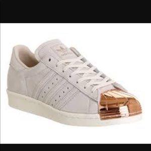 Adidas: gold shell toe- runs big